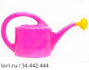 Purple watering can with yellow shower nozzle, white background. Стоковое фото, фотограф Кекяляйнен Андрей / Фотобанк Лори