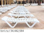 Hotel area are closed due to covid-19 pandemic, empty sun loungers are on resort area (2012 год). Стоковое фото, фотограф Кекяляйнен Андрей / Фотобанк Лори