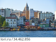 A view of Galata quarter of Istanbul with the Galata Tower through the Golden Horn. Turkeyj (2016 год). Редакционное фото, фотограф Serg Zastavkin / Фотобанк Лори
