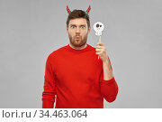 man in halloween costume of devil over grey. Стоковое фото, фотограф Syda Productions / Фотобанк Лори