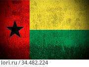 Weathered Flag Of Guinea-Bissau, fabric textured. Стоковое фото, фотограф Zoonar.com/Ruslan Gilmanshin / age Fotostock / Фотобанк Лори