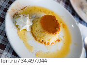 Tasty spanish dessert flan con nata served with caramel crust at plate. Стоковое фото, фотограф Яков Филимонов / Фотобанк Лори