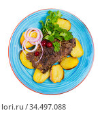 Prepared beef steak with fried potatoes and greens served. Стоковое фото, фотограф Яков Филимонов / Фотобанк Лори