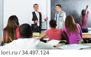 Man giving a math lesson. Стоковое фото, фотограф Яков Филимонов / Фотобанк Лори
