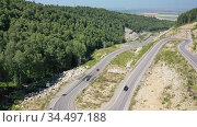 Видео горной дороги серпантина от Белокурихи на Белокуриху 2 на Алтае / Aerial video from lifting up drone on serpentine road to resort Belokurikha 2. Altai Krai, Russia. Редакционное видео, видеограф Serg Zastavkin / Фотобанк Лори