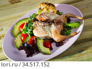 Image of quail-tobacco with sesame which served with salad of avocado and greenery. Стоковое фото, фотограф Яков Филимонов / Фотобанк Лори