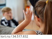 kids in halloween costumes having fun at home. Стоковое фото, фотограф Syda Productions / Фотобанк Лори