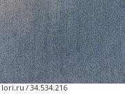 Джинсовый материал, фон. Текстура плотной хлопчатобумажной ткани. Стоковое фото, фотограф александр афанасьев / Фотобанк Лори