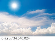Blue sky with clouds and sun. Стоковое фото, фотограф Zoonar.com/Dmitry Kushch / age Fotostock / Фотобанк Лори
