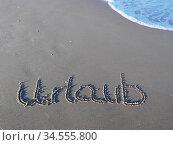 Urlaub in den Sand geschrieben. Стоковое фото, фотограф Zoonar.com/Gabriele Sitnik-Schmach / easy Fotostock / Фотобанк Лори