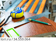 Carpentry tools a roulette of a pencil decorates manufacturing of... Стоковое фото, фотограф Zoonar.com/Ian Iankovskii / easy Fotostock / Фотобанк Лори