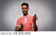 young indian man dancing over grey background. Стоковое видео, видеограф Syda Productions / Фотобанк Лори