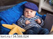 Portrait of a cute little boy in a cap and vest. Стоковое фото, фотограф Nataliia Zhekova / Фотобанк Лори