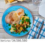 Fried Iberian pig served with potatoes. Стоковое фото, фотограф Яков Филимонов / Фотобанк Лори