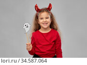 girl in halloween costume with ghost party prop. Стоковое фото, фотограф Syda Productions / Фотобанк Лори