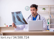 Young male doctor working in the clinic. Стоковое фото, фотограф Elnur / Фотобанк Лори