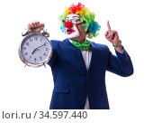 Funny clown businessman with an alarm clock isolated on white ba. Стоковое фото, фотограф Elnur / Фотобанк Лори