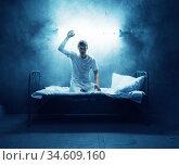 Psycho man in bed, insomnia, disorder, psychedelic. Стоковое фото, фотограф Tryapitsyn Sergiy / Фотобанк Лори