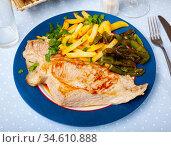 Fried Iberian pig served with potatoes, parsley, stewed pepper. Стоковое фото, фотограф Яков Филимонов / Фотобанк Лори
