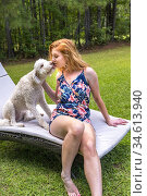 A 27 year old redhead woman with her dog in the backyard. Стоковое фото, фотограф Joseph De Sciose / age Fotostock / Фотобанк Лори