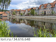 City view with timber-framed houses and Fulda river in Hann. Münden... Стоковое фото, фотограф Peter Schickert / age Fotostock / Фотобанк Лори