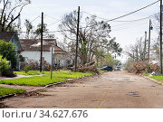 Lake Charles, Louisiana. USA - September 6, 2020:  Hurricane Laura. Destruction from strong winds. Rubbish, damaged roofs of houses, street, branches. Стоковое фото, фотограф Ирина Кожемякина / Фотобанк Лори