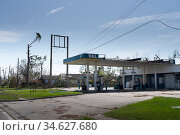 Lake Charles, Louisiana. USA - September 6, 2020:  Hurricane Laura. Destruction from strong winds. Ruined gas station, broken trees. Стоковое фото, фотограф Ирина Кожемякина / Фотобанк Лори