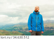 Rugged bearded man in in a membrane jacket headshot country masculine... Стоковое фото, фотограф Zoonar.com/Ian Iankovskii / easy Fotostock / Фотобанк Лори