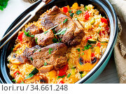 Fried rice with vegetables and meat. Стоковое фото, фотограф Zoonar.com/Darius Dzinnik / easy Fotostock / Фотобанк Лори