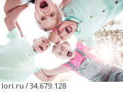 Group of smiling children looking down into camera. Стоковое фото, фотограф Zoonar.com/Tatiana Badaeva / easy Fotostock / Фотобанк Лори