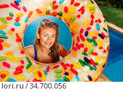 Cute girl in inflatable doughnut near pool. Стоковое фото, фотограф Сергей Новиков / Фотобанк Лори