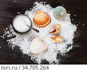 Top view of salt cellar, shells and coarse grained Sea Salt on dark... Стоковое фото, фотограф Zoonar.com/Valery Voennyy / easy Fotostock / Фотобанк Лори