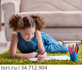 Young little girl drawing on paper with pencils. Стоковое фото, фотограф Elnur / Фотобанк Лори