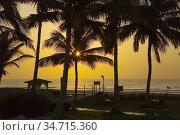 Sunrise over Indian Ocean at Hilton hotel in Salalah. Oman.. Стоковое фото, фотограф Andre Maslennikov / age Fotostock / Фотобанк Лори