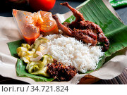 Nasi lemak kukus with quail, popular traditional Malay local food. Стоковое фото, фотограф Zoonar.com/szefei / easy Fotostock / Фотобанк Лори