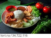 Nasi lemak kukus with fried drumstick, popular traditional Malaysian... Стоковое фото, фотограф Zoonar.com/szefei / easy Fotostock / Фотобанк Лори