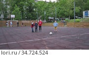 Children of all ages playing football AKA soccer game in residential district. Редакционное видео, видеограф Сергей Старуш / Фотобанк Лори
