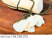 Sliced local italian Provola Affumicata (smoked provola) cheese on... Стоковое фото, фотограф Zoonar.com/Valery Voennyy / easy Fotostock / Фотобанк Лори