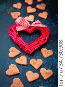 Valentine cookies with heart shape and decorative heart on dark blue... Стоковое фото, фотограф Zoonar.com/Burakova Irina / easy Fotostock / Фотобанк Лори