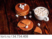 Stroopwafel with Broken One with White Cup of Cocoa with Marshmallow... Стоковое фото, фотограф Zoonar.com/Vsevolod Belousov / easy Fotostock / Фотобанк Лори