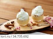 glasses of eggnog with whipped cream and anise. Стоковое фото, фотограф Syda Productions / Фотобанк Лори