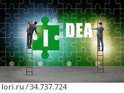 Idea concept with businessman putting jigsaw puzzle. Стоковое фото, фотограф Elnur / Фотобанк Лори