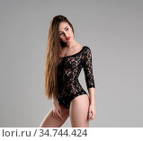 Studio image of long-haired babe posing in black lace bodysuit. Стоковое фото, фотограф Zoonar.com/Andrey Guryanov / easy Fotostock / Фотобанк Лори