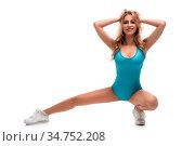 Sexy sporty woman wearing blue body isolated full-length shot. Стоковое фото, фотограф Zoonar.com/Andrey Guryanov / easy Fotostock / Фотобанк Лори