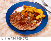 Grilled lamb with baked potato, homemade dinner. Стоковое фото, фотограф Яков Филимонов / Фотобанк Лори