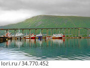 Tromso Bridge, cantilever road bridge in city of Tromso, in Troms county, Norway. Cloudy day (2016 год). Редакционное фото, фотограф Валерия Попова / Фотобанк Лори