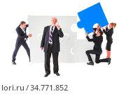 Business senior leadership concept. Business people with giant puzzle... Стоковое фото, фотограф Zoonar.com/Tatiana Badaeva / easy Fotostock / Фотобанк Лори