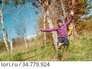 A man at the age of sitting on slackline, catching balance and enjoying... Стоковое фото, фотограф Zoonar.com/Ian Iankovskii / easy Fotostock / Фотобанк Лори