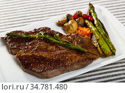 Prepared steak entrecote of beef with mushroom and asparagus. Стоковое фото, фотограф Яков Филимонов / Фотобанк Лори