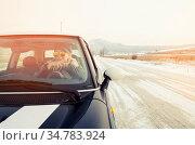 Hipster woman in sunglasses sitting in a small car in winter. Стоковое фото, фотограф Zoonar.com/Yankovsky Yan / easy Fotostock / Фотобанк Лори